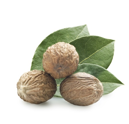 muscat: Nutmeg on a white background with a leaf