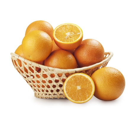 oranges in a beautiful basket isolated on white  Stock Photo - 13208996