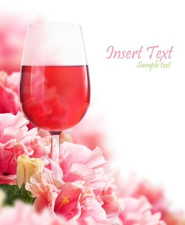 The beautiful backdrop of flowers hibiscus and a glass of wine Stock Photo