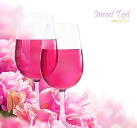 The beautiful backdrop of flowers hibiscus and glasses of wine photo