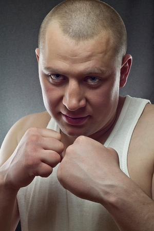 This is a photograph of a young man standing in a boxing position photo