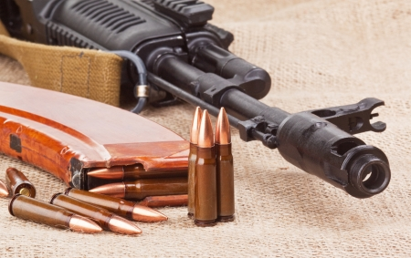 background with the cartridges and the AK47 photo