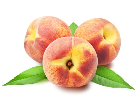 Ripe peach fruit with leaves on white background photo
