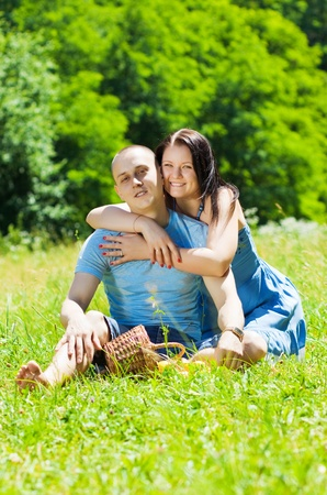 grass plot: young couple sitting on the grass in the park Stock Photo