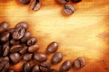 Coffee Beans over Wood Background  photo