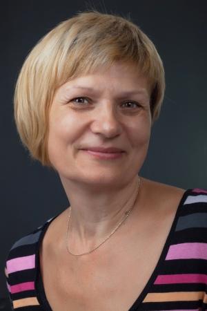Content female senior citizen smiling. Against a dark background