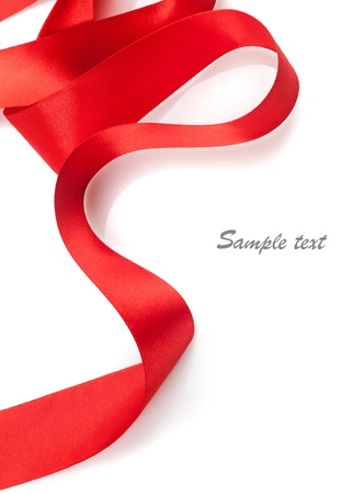 Beautiful red gift ribbon on a white background  photo