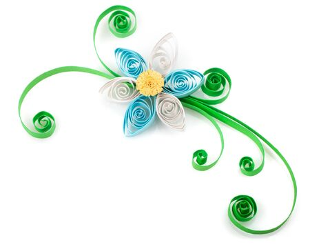 Quilling. Made of strips of paper flower on a white background photo