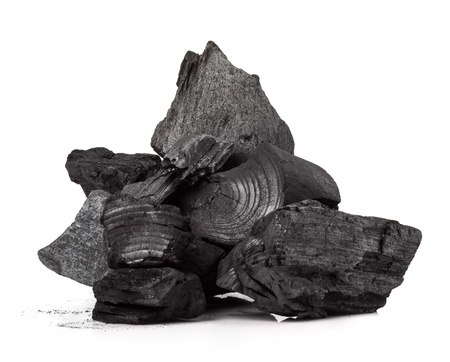 Piece of fractured wood coal isolated over white background photo