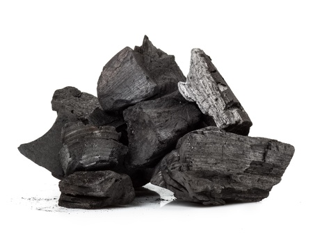 combustible: Piece of fractured wood coal isolated over white background Stock Photo