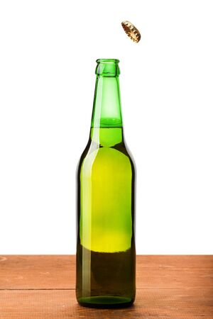 condensate: Beer bottle with a cork on a wooden board