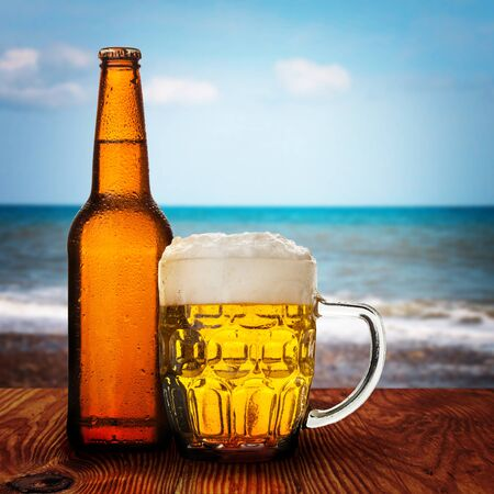 glass of beer with sea background  photo