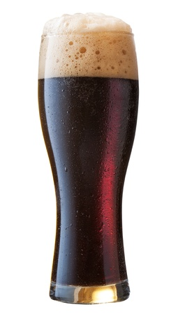 Frosty glass of black beer isolated on a white background photo
