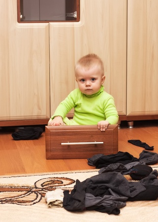 baby clothes scattered in the room and sat Stock Photo - 17499711