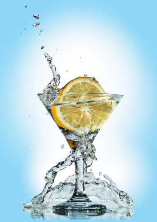 eject: water splash in glass of blue color. Clipping Path