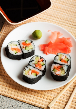 Delicious sushi rolls  with chopsticks  photo