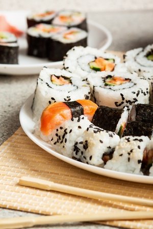grig: Delicious sushi rolls  with chopsticks