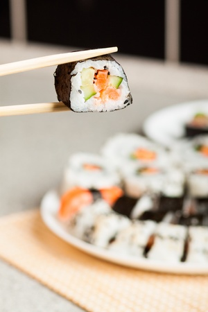 grig: Fresh Homemade Sushi Roll against a background Stock Photo