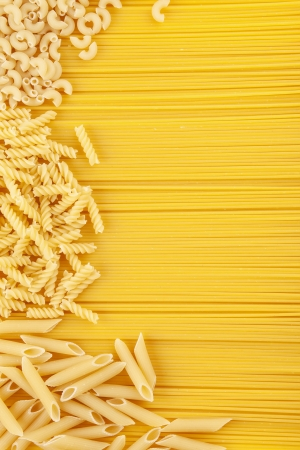 staple food: Pasta texture background. Pasta is a staple food of traditional Italian cuisine Stock Photo
