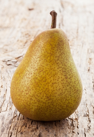 green pear on a wooden table Stock Photo