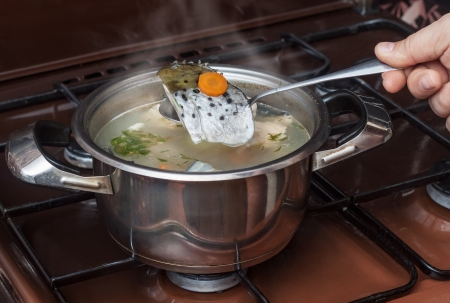 cooking fish soup, trout and vegetables  photo
