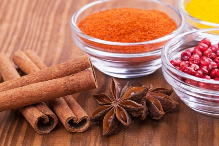 muscat: Herbs and Spices over wooden background