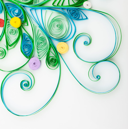 Quilling. Made of strips of paper snowflake on a white background  photo