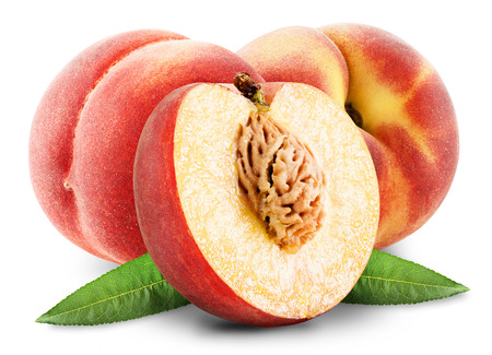 ripe peach with leaf on white background photo