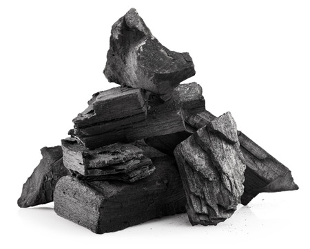 Piece of fractured wood coal isolated over white background Banco de Imagens