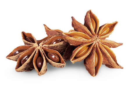star path: star anise in closeup over white background. Clipping Path Stock Photo
