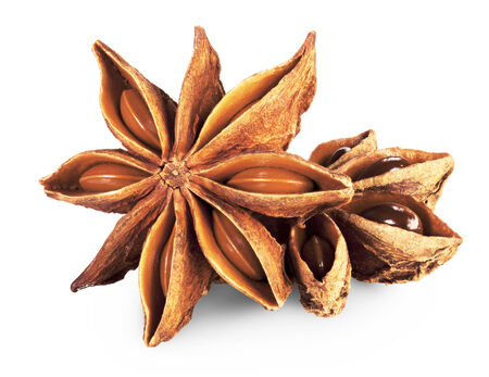 badiane: star anise in closeup over white background. Clipping Path Stock Photo
