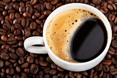background coffee beans with white cup  photo
