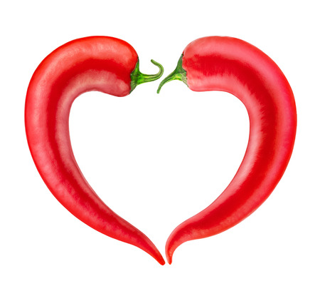 cayenne: Red chili pepper in the form of heart. Clipping path