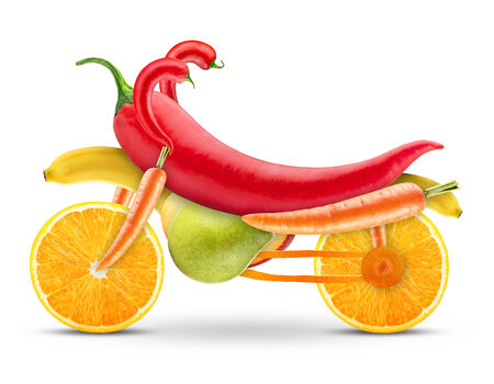 vegs: motorbike of fruits and vegetables on a white background Stock Photo