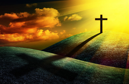 christian cross on sunset background for your design Banco de Imagens