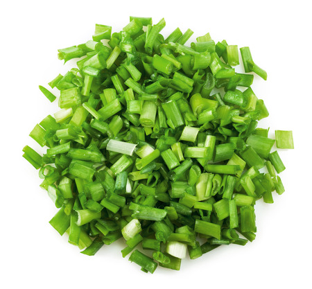 Fresh chopped green onions on a white background photo