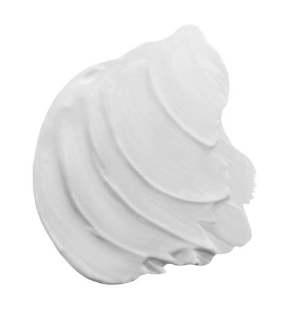 Slag van White Beauty Cream geïsoleerd op witte achtergrond. Clipping Path