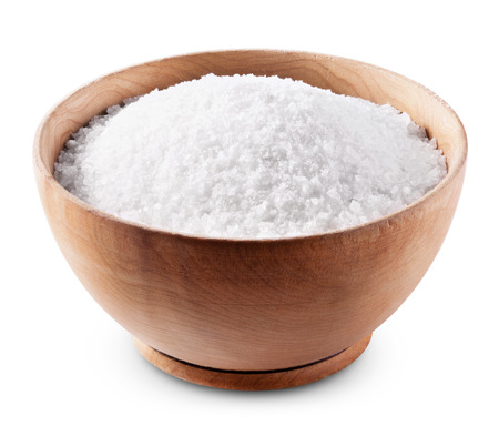 Sea salt in wooden bowl on white background