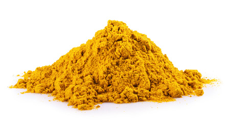 curcumin: turmeric spice pile on a white background