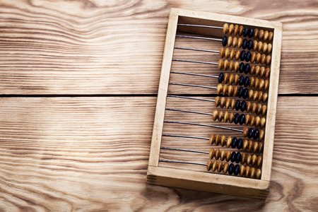 old abacus on the vintage wooden table