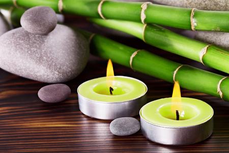 zen like: Spa Stones with bamboo on a wooden surface