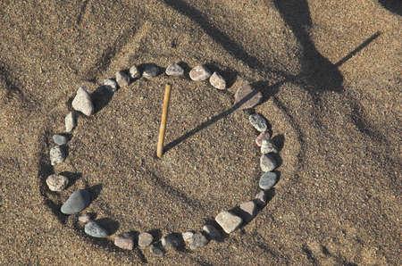 sun dial: Sundial on sea sand