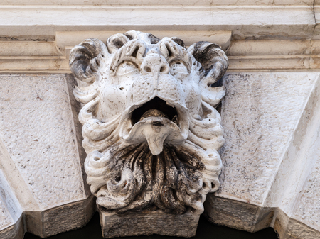 A carving of a Lions head over an archway in Venice, Italy