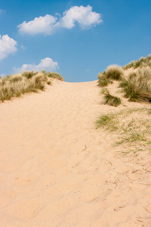 High sand dunes on a sunny day in Norfolk United Kingdom Stock Photo