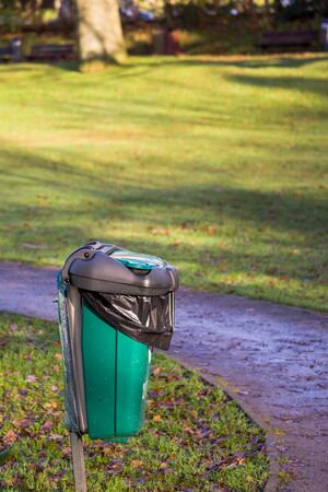 A dog waste bin in a local park Imagens