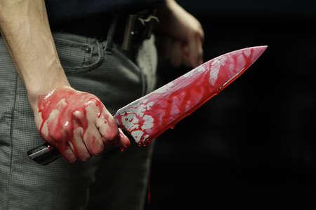 carnage: Man holding bloody knife