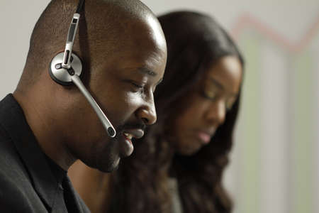 African American business man taking a sales call