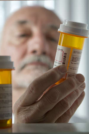 Senior man reaching for prescription medicine