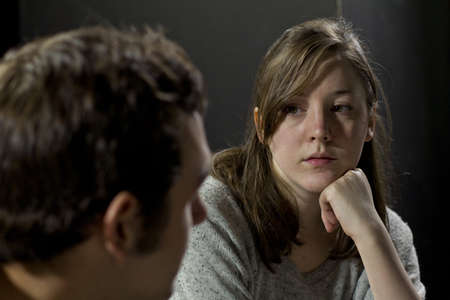 psychotherapy: Young girl listening to man s testimony