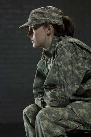 mental health problems: Young military woman with PTSD